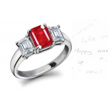 Ruby Diamond Three Stone Engagement Ring: Platinum ring with center ruby octagon and octagon diamonds.