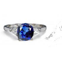 Harmony: A Simply Amazing Round Blue Sapphire & Pears Diamond Ring.