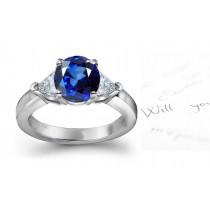 Harmony: A Fine Vivid Royal Blue & Trillion Diamond 3-Stone Ring.