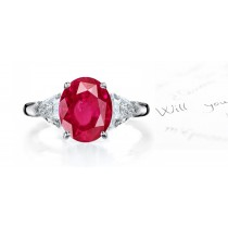 Classic Ruby Ring: Platinum ruby oval and diamond trillions three stone engagement ring