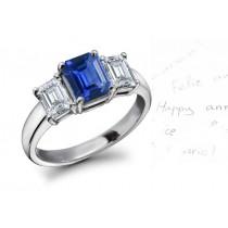 The Jacinth Sapphire: Simple & Classic 3 Stone Emerald Cut Fine Blue Sapphire & 2 Side Stone Emerald Cut Diamond Ring