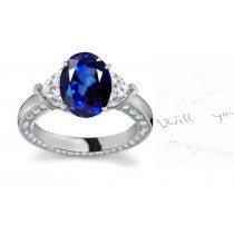 Noted As Regal Gem: 3 Stone Heart Diamond Side Gemstone Oval Fine Blue Sapphire Ring in Stone Sizes: 7x5, 8x6 mm