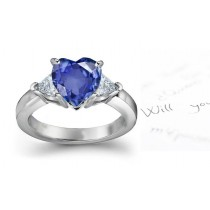 Rich Blue Hues: Bridegrooms Signature 3 Stone Pear Shaped Diamond & Heart Fine Deep Blue Sapphire Ring in Platinum & 14k Gold 2 mm thick Cost $3500