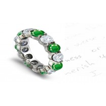 Classic Brilliant Cut Round Diamond & Bluish Green Emerald Shared-Prong Eternity Ring in Gold
