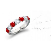 Anniversary Wedding Rings: Ruby diamond ring in platinum set with four round rubies and three round diamonds.