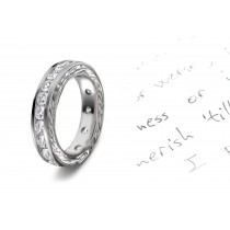 Timeless Creations: View This Stunning Platinum Wedding Band Decorated with Scrolling Flower and Petals Motifs