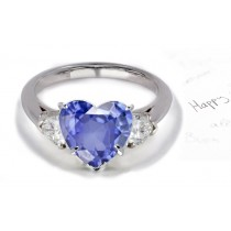 Heart-Shaped Blue tones: Fashioned in The Form of Rich Hue Butterfly 3 Stone Pear Diamond & Heart Fine Blue Sapphire Ring in White Gold