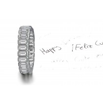 Strikingly Elegant: Seamlessly-Set Emerald Cut Diamonds in Secure Half-Bezel Gold Settings