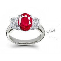 Crimson Red Ruby & Diamond Engagement Ring: Platinum ring with round center diamond & two side round brilliant rubies.