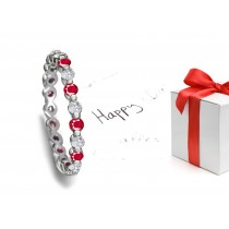 Fascinating: Bar Set Round Ruby & Diamond Eternity Band in Polished Platinum & 14k Gold
