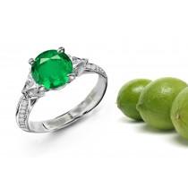 Plain Skeleton Mountings: This Three Stone Ring Features Trillion Diamonds & A Round Emerald Stone