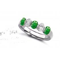 Design & Style: Five Stone Oval Diamond Emerald Anniversary Ring