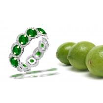 Halo Diamond & Emerald Anniversary Ring