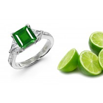 Diamonds With Emeralds: This different and vaied 3 Stone Ring Features Trillion Diamonds & A Square Emerald