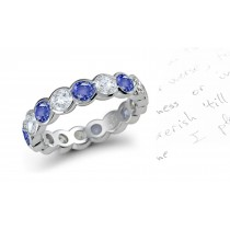 Glowing: Half Bezel Set Round Blue Sapphire & Diamond Eternity Band