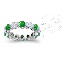 Dramatic EmeraldJewelry Eternity Rings:Well crafted round emeralds & diamond bar set in alternating fashion with colorless minimal flaw diamonds in gold or platinum settings.