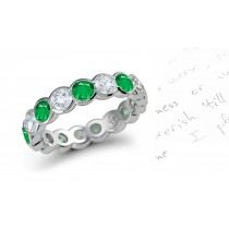Forever Yours Emerald Jewelry Eternity Rings: Custom Made Emerald & Diamond Bezel Set in White Gold.
