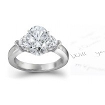 Three Stone Oval Diamond & Side Heart Diamonds Three Stone Anniversary Ring