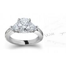 Diamond 3-Stone Ring: 3-Stone (Ring with RoundTrillion Diamonds) Rings in Platinum & 14K White Yellow Gold.