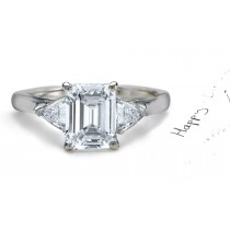 Diamond Anniversary Ring: Three Stone (Center Emerald Cut & Side Trillion Diamonds) Platinum & 14K White Yellow Gold.