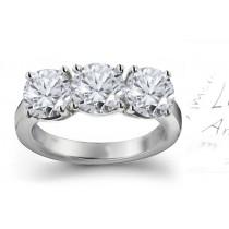 Three Stone Diamond Rings: Three Stone Diamond (Rings with Round Diamonds) Ring in Platinum & 14K White Yellow Gold.