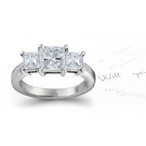Diamond Anniversary Ring: Three Stone (Center Emerald Cut & Side Trillion Diamonds) Platinum & 14K White Yellow Gold.