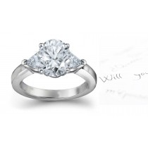 Three Stone Diamond Anniversary Ring: Three Stone Diamond (Rings with Oval & Trillion Diamonds) Ring in Platinum & 14K White Yellow Gold.