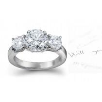 Diamond Anniversary Rings: Three-Stone (Ring with Three Round Diamonds) Rings in Platinum & 14K Gold.