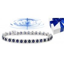 Gold Sapphire and Diamond Tennis Bracelet.