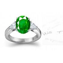 Stunning Emerald & Diamond Three-Stone Anniversary Rings
