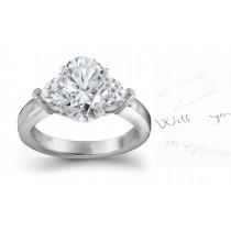 Three Stone Oval Diamond & Side Heart Diamonds Three Stone Anniversary Ring