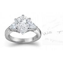 Three Stone Pears Diamond & Side Heart Diamonds Three Stone Anniversary Ring