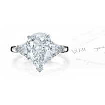 Center Pears & Side Trillion Diamonds Three Stone Ring