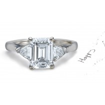 Anniversary Ring: Three Stone (Emerald Cut and Trillion Diamonds) Rings in Platinum.
