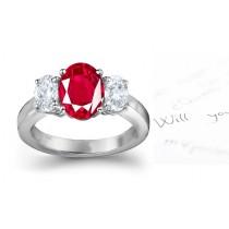 Three Stone Ruby and Diamond Ring: Three Stone (Three Oval Ruby and Diamonds) Rings in Platinum.
