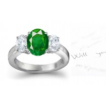 Emerald Diamond 3 Stone Rings: Three Stone (Oval Emerald and Diamonds) Rings in Platinum.