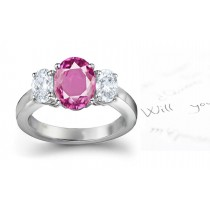 The Maggiore Collection: 3 Stone Ladies Pink Oval Sapphire & Oval White Diamonds Ring