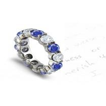 Brilliant: Prong Set Blue Sapphire & Diamond Eternity Wedding Bandin Gold 1 to 5 vts tw